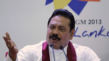 Sri Lanka's President Rajapaksa speaks during a news conference in Colombo