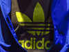The Adidas logo is pictured on a shirt during the company's annual news conference in Herzogenaurach
