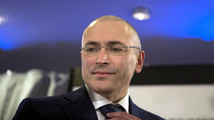 With Khodorkovsky out, Yukos investors fight on