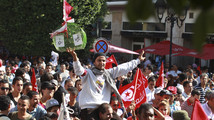 Protesters shout slogans during demonstration to call for the departure of the Islamist-led ruling coalition in Avenue Habib-Bourguiba in central Tunis