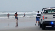 Kids rescued from surf: 'Mom tried to kill us'