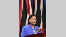 Trinidad and Tobago's Prime Minister and chairperson of CARICOM Persad-Bissessar addresses a media conference in St Ann's