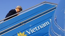 U.S. Secretary of State John Kerry boards his plane in Hanoi
