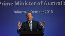 Australia's Prime Minister Tony Abbott speaks at a breakfast meeting in Jakarta