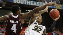 Missouri holds off Texas A&M; at SEC 91-83 in 2OT
