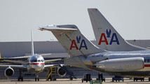 American Airlines airliners sit near a hanger at Dallas/Fort Worth International Airport, Texass