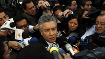 David Penchyna, leader of the Senate's energy committee and member of Institutional Revolutionary Party, speaks to the media before a debate on an energy reform bill at the Senate in Mexico City