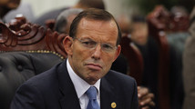 Australia's PM Abbott attends a session of the CHOGM in Colombo