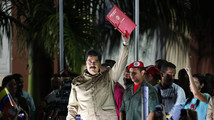 Venezuelan President Maduro greets supporters after receiving a law which grant him with decree powers in Caracas