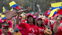 Venezuelans mourn Chavez but protests don't break