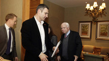 U.S. Senator McCain reacts as Ukrainian opposition leader Klitschko looks on during their meeting in Kiev