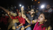 People chant slogans as they attend a sit-in protest at Shahbagh intersection demanding capital punishment for Bangladesh's Jamaat-e-Islami senior leader Abdul Quader Mollah in Dhaka