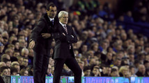 Everton's manager Martinez gestures as his Stoke City counterpart Hughes looks on during their English Premier League soccer match in Liverpool
