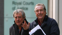 Monty Python members Eric Idle and Terry Jones leave the High Court during a lunch break in central London