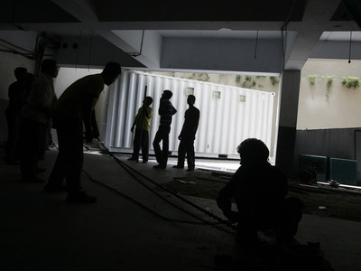 Labourers pull a container at the basement of the Four Points hotel in the western Indian city of Ahmedabad