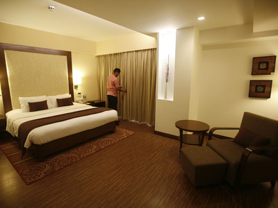 An employee prepares a room for guests at the Four Points hotel in the western Indian city of Ahmedabad
