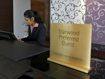 An employee works at the reception of the Four Points hotel in the western Indian city of Ahmedabad