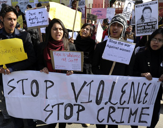 Nepalese activists protest over violence against women in Kathmandu on January 6, 2013