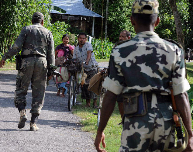 Paramilitary soldiers walk through the Kokrajhar district of the northeastern state of Assam on July 27, 2012