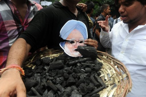Activists hold a photo of Indian PM Manmohan Singh during a protest against the coal allocation controversy