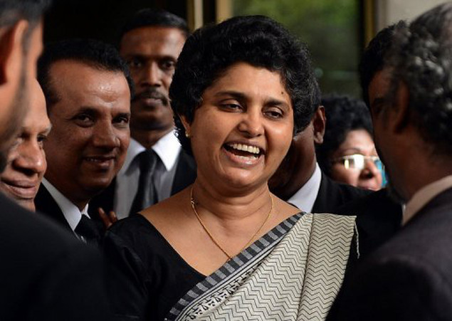 <p>Sri Lanka's Chief Justice Shirani Bandaranayake (C) leaves the Supreme Court in Colombo on November 23. Sri Lankan lawyers have asked the Supreme Court to declare parliament's impeachment of Bandaranayake illegal, a legal spokesman said Tuesday, a move that could trigger a constitutional crisis.</p>