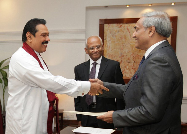President Mahinda Rajapakse (left) shakes hands with Mohan Peiris after appointing him chief justice on January 15
