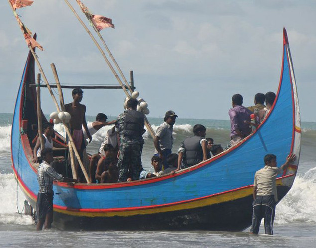 Rohingya refugees are pictured on a fishing boat following rescue by Bangladeshi border guards on November 7, 2012