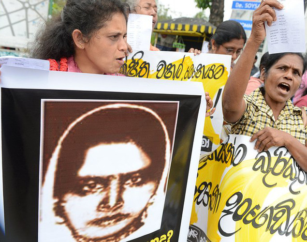 Sri Lankan activists hold up a portrait of executed nanny Rizana Nafeek in a protest in Colombo on January 11, 2013
