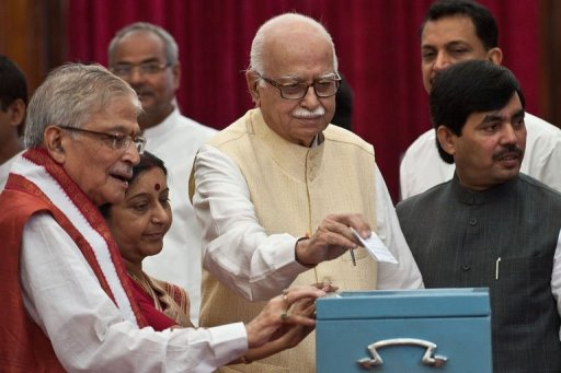 Senior Bhartiya Janata Party President L.K. Advani (C) casts his vote during the election for Vice President