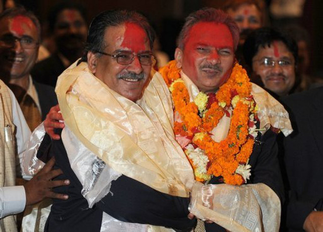 <p>File photo of Nepal's prime minister Baburam Bhattarai (right) and Unified Communist Party of Nepal (Maoist) Chairman Pushpa Kamal Dahal, also known as Prachanda, in Kathmandu. Nepal's Maoists are locked in urgent talks with opposition parties as a deadline passes to form a unity government to end political turmoil and steer the country towards elections.</p>