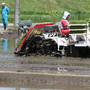 Farmers plant rice near crippled Fukushima site