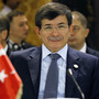Davutoglu smiles during the 12th Asia Cooperation Dialogue Ministerial Meeting in Manama