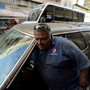 Venezuela car owners unfazed by planned fuel hike
