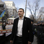 Klitschko walks past supporters and police outside parliament in Kiev