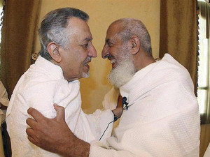 Saudi Grand Mufti Sheikh Abdul-Aziz Al al-Sheikh embraces Saudi Prince Khaled Al Faisal, Emir of Mecca, at Namira Mosque on the plains of Arafat, outside Mecca