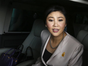 Prime Minister Yingluck Shinawatra leaves Army Club where she held a cabinet meeting in Bangkok
