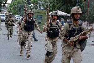 Afghan special forces arrive at the site of a clash with Taliban fighters in Kabul on May 24, 2013