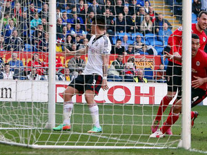 United bounce back, Cardiff cut Fulham adrift