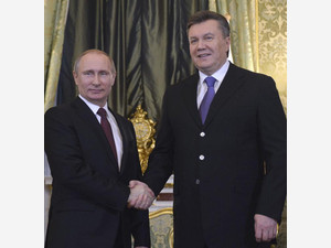 Russia's President Vladimir Putin (left) shakes hands with his Ukrainian counterpart Viktor Yanukovych during their meeting at the Kremlin in Moscow, on December 17, 2013
