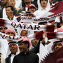 Qatari fans cheer before the start of the 2011 Asian Cup quarter-final football match between Qatar and Japan in the Qatari capital Doha on January 21, 2011
