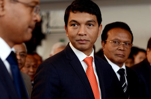 Madagascar strongman Andry Rajoelina, pictured (C) at a ceremony in Antananarivo Town Hall, on May 13, 2013