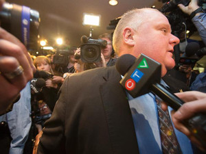 Toronto Mayor Rob Ford is surrounded by the media as he waits for an elevator outside his office at Toronto City Hall on November 15, 2013 in Toronto, Canada