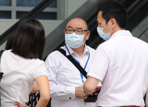 People wear face masks as haze worsens in Singapore, on June 19, 2013