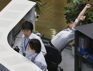 Asian stocks higher on hopes US will keep stimulus