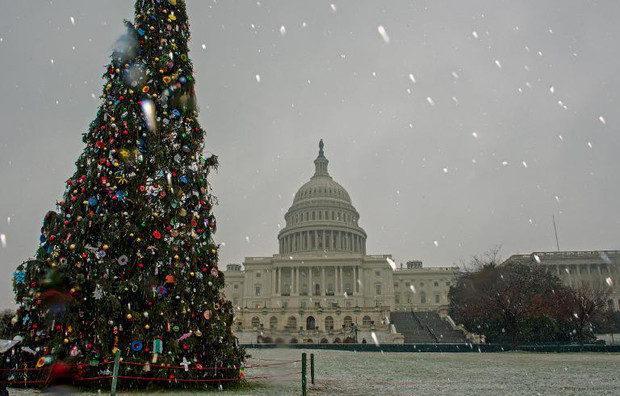 Light snow falls around the US Capitol on December 10, 2013, in Washington, DC