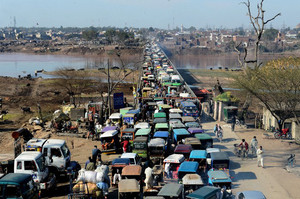 Commuters are seen being stuck in a traffic jam near Lahore, on February 8, 2013