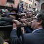Bogota Mayor Gustavo Petro shakes hands with residents of the