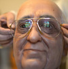 Fernando Canini, director of Rome's wax museum, gives the final touch to the new wax statue representing Pope Francis, on December 5, 2013 in Rome