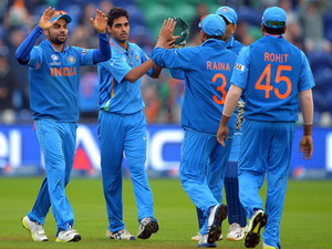 Bhuvneshwar Kumar (2nd left) celebrates after claiming the wicket of Kusal Perera in Cardiff on June 20, 2013