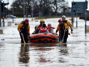 File picture shows an elderly couple being rescued by a team from the Royal National Lifeboat Institute (RNLI)